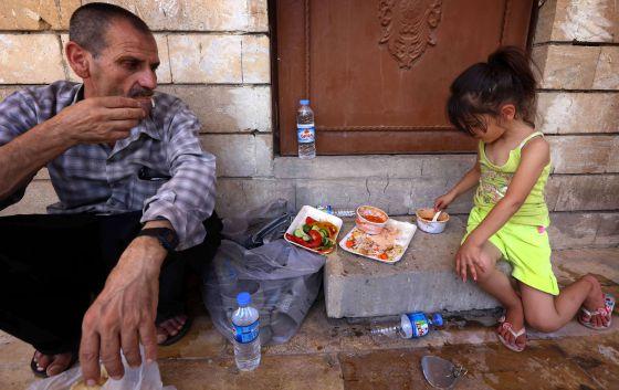 cristianos huyen Irak 2014