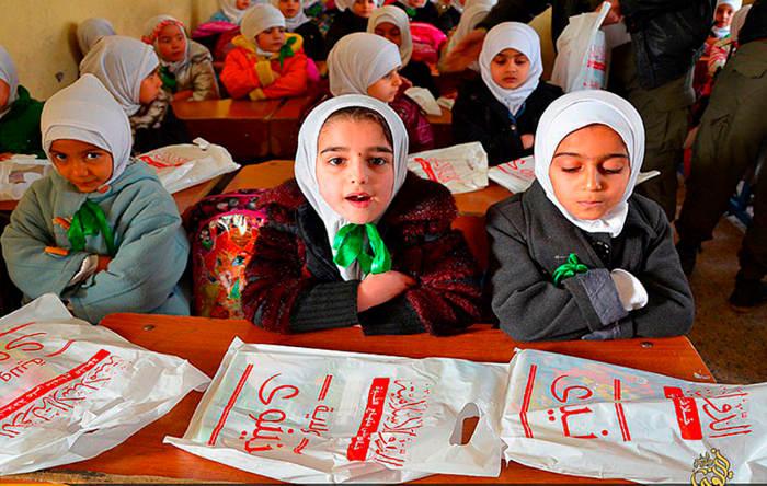 Unas niñas en una escuela de Mosul, 'capital iraquí' del califato. E.M